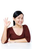 Woman with OK hand sign Stock Photography