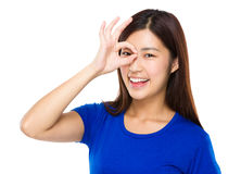Woman with ok sign on eye Royalty Free Stock Image