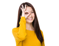 Woman with ok sign on eye Royalty Free Stock Photo