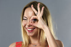 woman with ok sign on her eye Stock Photo