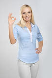 Woman with okay gesture Royalty Free Stock Photography