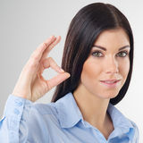 Woman with okay. Portrait smiling woman with okay gesture Royalty Free Stock Images