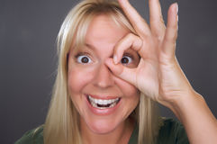 Woman with Okay Sign in Front of Face Royalty Free Stock Image