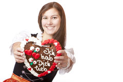 Woman in Oktoberfest dirndl holds heart Royalty Free Stock Photos