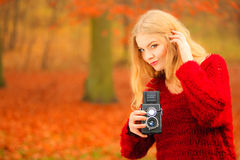 Woman with old camera outdoor Stock Photo