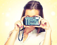 Woman with old camera Royalty Free Stock Images