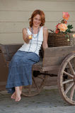 Woman in old cart Royalty Free Stock Image
