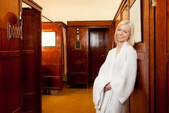 Woman in Old European Spa. Portrait of an attractive blonde woman in an old 1920s style european spa and bath house Royalty Free Stock Photo