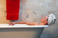 Woman in old fashion clawfoot tub Stock Photo