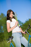 Woman with old-fashioned bike and summer flower Royalty Free Stock Photography