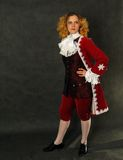 Woman in old-fashioned french clothes Royalty Free Stock Image