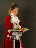 Woman in old-fashioned french clothes Royalty Free Stock Photos