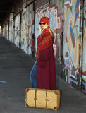 Woman with an old fashioned suitcase Royalty Free Stock Image