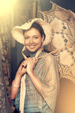 Woman in old hat with a lace umbrella Stock Photo