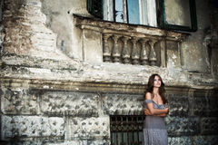 woman by old house portrait Stock Image