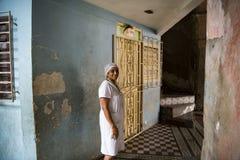 Woman at entrance of house, Santiago de Cuba Royalty Free Stock Photo