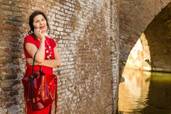 Woman in old Italian village Stock Images