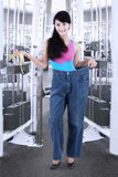 Woman with old jeans at gym center Royalty Free Stock Photos