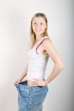 Woman in old jeans pant after losing weight Stock Image