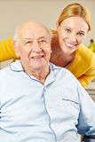 Woman and old man smiling Royalty Free Stock Image