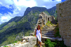 Woman in old mountain fortress stock image