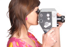 Woman with old movie camera Stock Photos