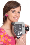 Woman with old movie camera Royalty Free Stock Photo