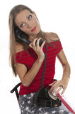 Woman with an old phone Stock Photo