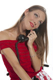 Woman with an old phone Royalty Free Stock Photos