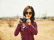 Woman with old photo camera in autumn outdoor Stock Images