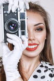 Woman with old photo camera Royalty Free Stock Image