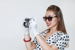 Woman with old photo camera Royalty Free Stock Photography
