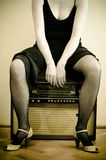 Woman and an old radio Royalty Free Stock Photos