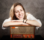 Woman with old retro radio Royalty Free Stock Photo