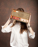 Woman with old retro radio Stock Images