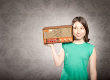 Woman with old retro radio Royalty Free Stock Images