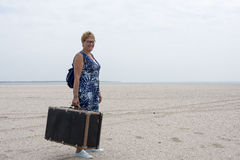 Woman with old suitcase Royalty Free Stock Images