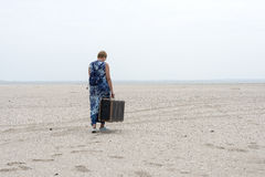 Woman with old suitcase Stock Photography