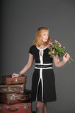 Woman and old suitcases. Young woman and a lot of old suitcases Royalty Free Stock Image