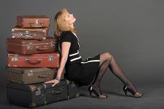 Woman and old suitcases Stock Photography