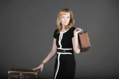 Woman and old suitcases Royalty Free Stock Image