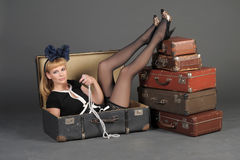 Woman and old suitcases. Young woman and a lot of old suitcases Stock Image