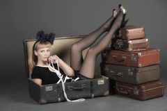 Woman and old suitcases. Young woman and a lot of old suitcases Stock Photos