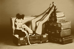 Woman and old suitcases. Young woman and a lot of old suitcases Royalty Free Stock Photo