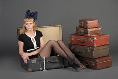 Woman and old suitcases Stock Image