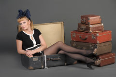 Woman and old suitcases Stock Photos