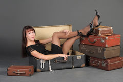 Woman and old suitcases Stock Images