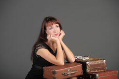 Woman and old suitcases Royalty Free Stock Images