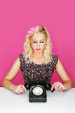 Woman with old telephone Stock Photo