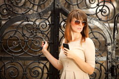 Woman in old town Gdansk with phone Royalty Free Stock Photos